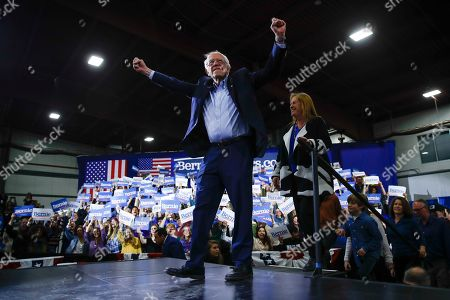Democratic presidential candidate Sen. Bernie Sanders, I-Vt., accompanied by his wife Jane O'Meara Sanders, arrives at a primary night election rally in Essex Junction, Vt