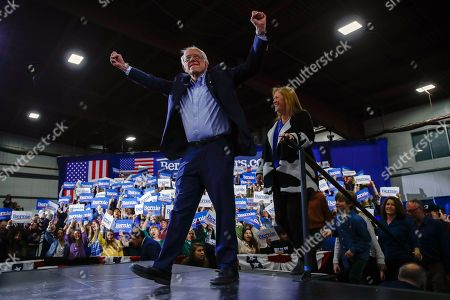 Democratic presidential candidate Sen. Bernie Sanders, I-Vt., accompanied by his wife Jane O'Meara Sanders, speaks during a primary night election rally in Essex Junction, Vt