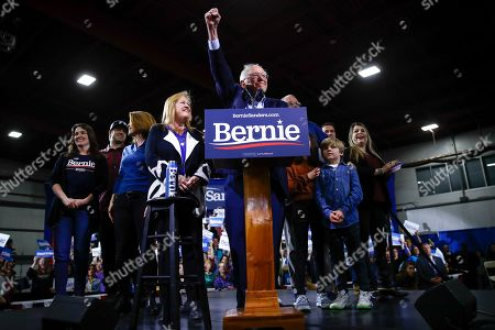 Democratic presidential candidate Sen. Bernie Sanders, I-Vt., accompanied by his wife Jane O'Meara Sanders and other family members speaks during a primary night election rally in Essex Junction, Vt