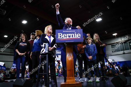 Democratic presidential candidate Sen. Bernie Sanders, I-Vt., accompanied by his wife Jane O'Meara Sanders and other family members, speaks during a primary night election rally in Essex Junction, Vt