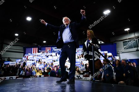 Democratic presidential candidate Sen. Bernie Sanders, I-Vt., accompanied by his wife Jane O'Meara Sanders, arrives to speak during a primary night election rally in Essex Junction, Vt