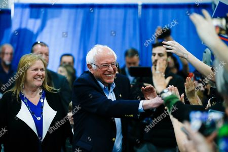 Democratic presidential candidate Sen. Bernie Sanders, I-Vt., accompanied by his wife Jane O'Meara Sanders, greets supporters during a primary night election rally in Essex Junction, Vt
