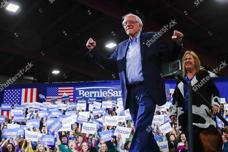 Stock Image of Democratic presidential candidate Sen. Bernie Sanders, I-Vt., accompanied by his wife Jane O'Meara Sanders, arrives at a primary night election rally in Essex Junction, Vt