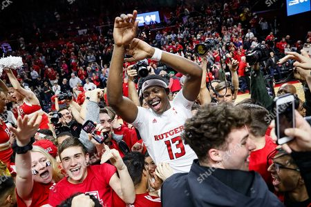 Stock Picture of Rutgers' Shaq Carter (13) celebrates with fans after Rutgers defeated Maryland in an NCAA college basketball game, in Piscataway, N.J