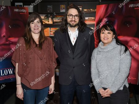 """Mollye Asher, Carlo Mirabella-Davis, Mynette Louie. Director Carlo Mirabella-Davis, center, poses with producers Mollye Asher, left, and Mynette Louie at a special screening of """"Swallow"""" at NeueHouse Madison Square, in New York"""
