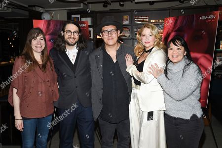 """Stock Image of Mollye Asher, Carlo Mirabella-Davis, Joe Wright, Haley Bennett, Mynette Louie. Producer Mollye Asher, left, director Carlo Mirabella-Davis, executive producer Joe Wright, actress Haley Bennett and producer Mynette Louie pose together at a special screening of """"Swallow"""" at NeueHouse Madison Square, in New York"""