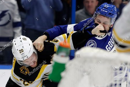 Tampa Bay Lightning center Yanni Gourde (37) and Boston Bruins center Joakim Nordstrom (20) exchange punches during a fight during the second period of an NHL hockey game, in Tampa, Fla