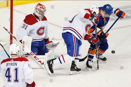 Carey Price, Xavier Ouellet, Jean-Gabriel Pageau, Paul Byron. Montreal Canadiens defenseman Xavier Ouellet (61) defends against New York Islanders center Jean-Gabriel Pageau