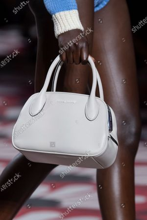 Stock Picture of Adut Akech on the catwalk, bag detail