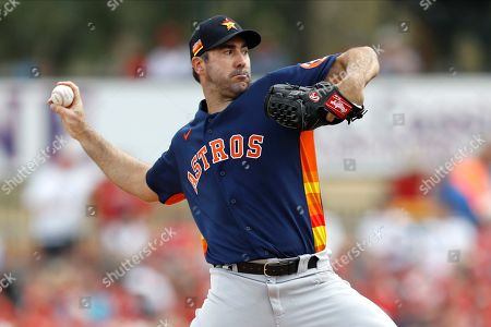 Houston Astros pitcher Justin Verlander throws to the St. Louis Cardinals during the first inning of a spring training baseball game, in Jupiter, Fla
