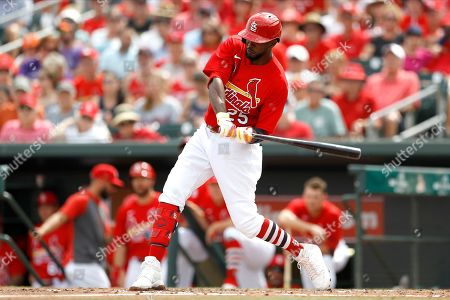 St. Louis Cardinals' Dexter Fowler swings at a pitch from Houston Astros pitcher Justin Verlander during the second inning of a spring training baseball game, in Jupiter, Fla