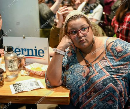 Jessica Garraway of Minneapolis and a supporter of US Senator from Vermont Bernie Sanders watches the election results at Black Stag Brewing brew pub on Super Tuesday in St. Paul, Minnesota USA, 03 March 2020. Fourteen states are holding their primaries with more than one third of the total pledged delegates in the Democratic primaries to be awarded on Super Tuesday.