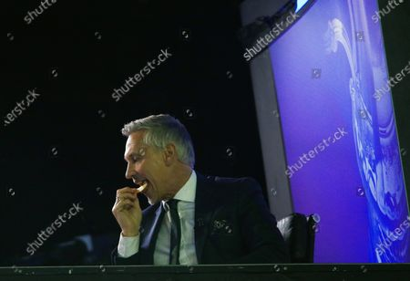 Gary Lineker eats Walkers crisps as he watches the game