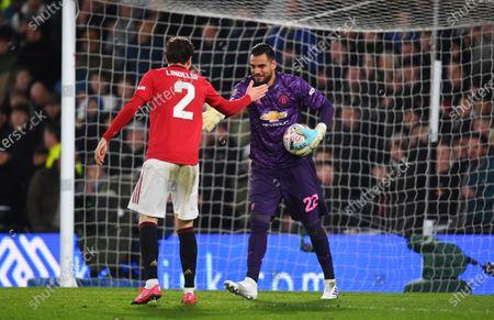 Victor Lindelof congratulates Sergio Romero goalkeeper of Manchester United