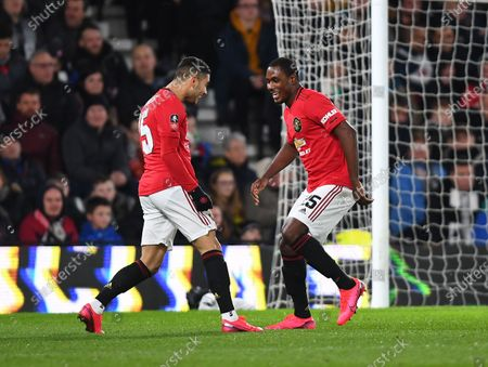 Odion Ighalo of Manchester United celebrates with Andreas Pereira after scoring his side's third goal
