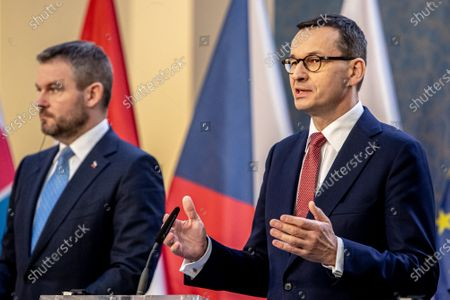 Slovak Prime Minister Peter Pellegrini (L) and Polish Prime Minister Mateusz Morawiecki (R) attend a press conference during the Visegrad Group (V4) summit in Prague, Czech Republic, 04 March 2020. The extraordinary summit will focus on the ongoing novel coronavirus outbreak in Europe.