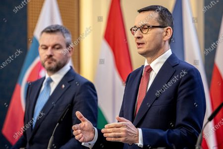Stock Image of Slovak Prime Minister Peter Pellegrini (L) and Polish Prime Minister Mateusz Morawiecki (R) attend a press conference during the Visegrad Group (V4) summit in Prague, Czech Republic, 04 March 2020. The extraordinary summit will focus on the ongoing novel coronavirus outbreak in Europe.