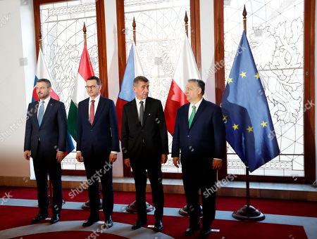 Stock Picture of Prime Ministers of Slovakia Peter Pellegrini, left, Poland Mateusz Morawiecki, 2nd left, Czech Republic Andrej Babis, 2nd right, and Hungary Viktor Orban, right, pose for a family photo as they meet for a V-4 summit in Prague, Czech Republic, . The Prime Ministers met to discuss mainly the situation of the spread of the new COVID-19 coronavirus
