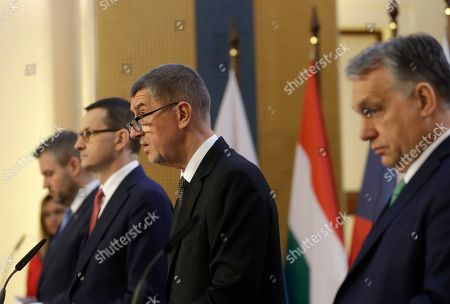 Stock Photo of Prime Ministers of Slovakia Peter Pellegrini, left, Poland Mateusz Morawiecki, 2nd left, Czech Republic Andrej Babis, 2nd right, and Hungary Viktor Orban, right, address media during their joint press conference during a V-4 summit in Prague, Czech Republic, . The Prime Ministers met to discuss mainly the situation of the spread of the new COVID-19 coronavirus and immigration