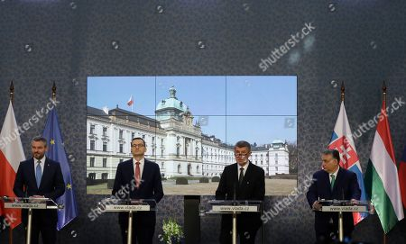 Prime Ministers of Slovakia Peter Pellegrini, left, Poland Mateusz Morawiecki, 2nd left, Czech Republic Andrej Babis, 2nd right, and Hungary Viktor Orban, right, address media during their joint press conference during a V-4 summit in Prague, Czech Republic, . The Prime Ministers met to discuss mainly the situation of the spread of the new COVID-19 coronavirus and immigration