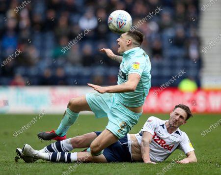 Jordan Hugill of QPR is fouled by Ben Davies of Preston North End