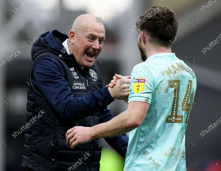 QPR manager Mark Warburton celebrates at the end of the match with Ryan Manning