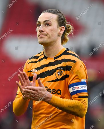 Jackson Irvine of Hull City applauds the fans at the end of the game