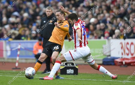 Jackson Irvine of Hull City tackled by Tommy Smith of Stoke City