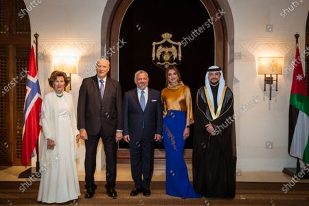 Stock Photo of Their Majesties King Abdullah II and Queen Rania and His Royal Highness Crown Prince Al Hussein bin Abdullah II at the dinner banquet held in honor of Their Majesties King Harald V and Queen Sonja in Amman