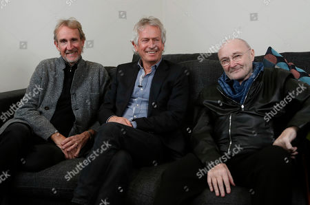 Genesis band members from left, Mike Rutherford, Tony Banks, and Phil Collins, pose for a photo, during an interview with Associated Press in London, . The band are reuniting for their first tour in 13 years