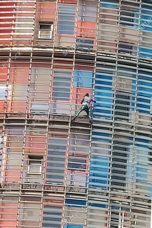 French urban climber Alain Robert climbs the Glories Tower in Barcelona, Spain, 04 March 2020. Alain managed to reach the 26th floor before firefighters demanded him not to continue up to the 34th floor and convinced him to enter the building. Alain Robert did not follow their instructions but started to descend the tower.