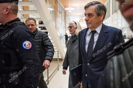 Former French Prime Minister Francois Fillon (R) and his wife Penelope (C, back) arrive at the courthouse in Paris, France, 04 February 2020. The ex-prime minister is accused of employing his wife Penelope as a highly-paid aide for years despite the lack of evidence that she performed any legitimate work.