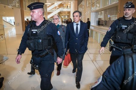 Former French Prime Minister Francois Fillon (C) and his wife Penelope (C-L) arrive at the courthouse in Paris, France, 04 February 2020. The ex-prime minister is accused of employing his wife Penelope as a highly-paid aide for years despite the lack of evidence that she performed any legitimate work.
