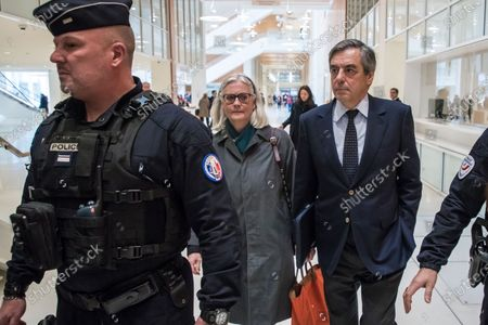Former French Prime Minister Francois Fillon (R) and his wife Penelope (2-R) arrive at the courthouse in Paris, France, 04 February 2020. The ex-prime minister is accused of employing his wife Penelope as a highly-paid aide for years despite the lack of evidence that she performed any legitimate work.