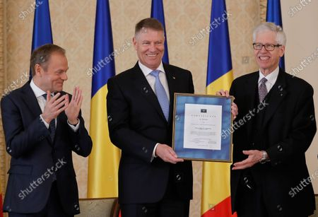 Romanian President Klaus Iohannis (C) receives from Prince Nikolaus of Liechtenstein (R) the 'European Society Coudenhove-Kalergi 2020' prize, as European People's Party (EPP) President Donald Tusk (L) applauds, during a ceremony in Bucharest, Romania, 04 March 2020. The Coudenhove-Kalergi European Prize is awarded every two years to citizens of Europe for exceeding accomplishments in the European unification process and for promoting European values.