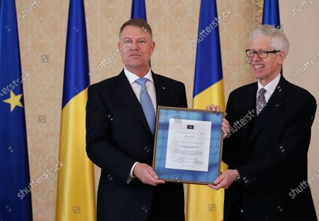 Romanian President Klaus Iohannis (L) receives from Prince Nikolaus of Liechtenstein (R) the 'European Society Coudenhove-Kalergi 2020' prize during a ceremony in Bucharest, Romania, 04 March 2020. The Coudenhove-Kalergi European Prize is awarded every two years to citizens of Europe for exceeding accomplishments in the European unification process and for promoting European values.
