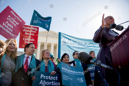 Stock Picture of Ayanna Pressley, Debbie Mucarsel-Powell, Jamie Raskin, Sylvia Garcia, Judy Chu, Andy Levin, Lori Trahan. Rep. Ayanna Pressley, D-Mass., right, accompanied by from left, Rep. Debbie Mucarsel-Powell, D-Fla., Rep. Jamie Raskin, D-Md., Rep. Sylvia Garcia, D-Texas, Rep. Judy Chu, D-Calif., Rep. Andy Levin, D-Mich., and Rep. Lori Trahan, D-Mass., speaks at an abortion rights rally outside the Supreme Court, in Washington, as the court takes up the first major abortion case of the Trump era Wednesday, an election-year look at a Louisiana dispute that could reveal how willing the more conservative court is to roll back abortion rights