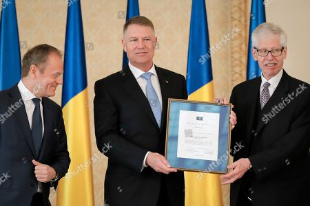 Romanian President Klaus Iohannis, centre, poses with Prince Nikolaus of Liechtenstein, right, and European People's Party (EPP) President Donald Tusk after receiving the 2020 European Society Coudenhove-Kalergi prize at the Cotroceni presidential palace in Bucharest, Romania