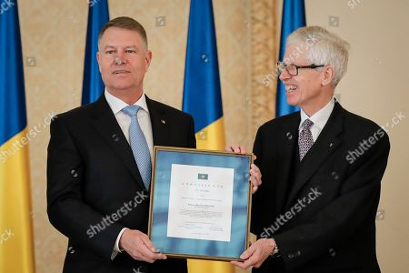 Stock Picture of Romanian President Klaus Iohannis, poses with Prince Nikolaus of Liechtenstein, right, after receiving the 2020 European Society Coudenhove-Kalergi prize at the Cotroceni presidential palace in Bucharest, Romania