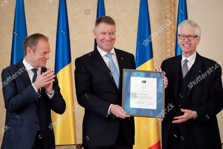 Romanian President Klaus Iohannis, centre, poses with Prince Nikolaus of Liechtenstein, right, and European People's Party (EPP) President Donald Tusk, after receiving the 2020 European Society Coudenhove-Kalergi prize at the Cotroceni presidential palace in Bucharest, Romania