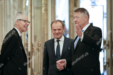Romanian President Klaus Iohannis welcomes Prince Nikolaus of Liechtenstein, left, and European People's Party (EPP) President Donald Tusk before receiving the 2020 European Society Coudenhove-Kalergi prize at the Cotroceni presidential palace in Bucharest, Romania