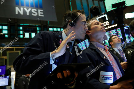 Stock Photo of Gregory Rowe, Robert Charmak. Gregory Rowe, left, whispers in the ear of fellow trader Robert Charmak as they work on the floor of the New York Stock Exchange, . Stocks are surging in early trading on Wall Street, led by health care stocks after Joe Biden scored a number of Super Tuesday wins
