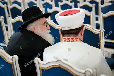 Romania's Rabbi Rafael Schaffer sits with Murat Iusuf, the Mufti of Romania's Muslim community, before a ceremony where Romanian President Klaus Iohannis was presented with the 2020 European Society Coudenhove-Kalergi prize by Prince Nikolaus of Liechtenstein at the Cotroceni presidential palace in Bucharest, Romania
