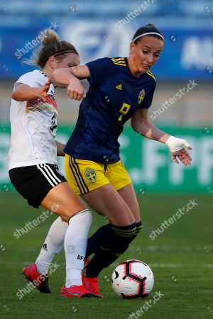 Sweden's Kosovare Asllani is fouled by Germany's Svenja Huth, left, during the Algarve Cup women's soccer match between Germany and Sweden at the Algarve stadium, outside Faro, Portugal