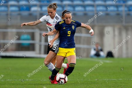 Sweden's Kosovare Asllani is fouled by Germany's Klara Buhl, left, during the Algarve Cup women's soccer match between Germany and Sweden at the Algarve stadium, outside Faro, Portugal