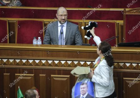Stock Image of Denys Shmygal (C) reacts as lawmaker presents him a cat toy and a bag with portrait of former President Viktor Yanukovych during extraordinary session of Ukrainian Parliament in Kiev, Ukraine, 04 March 2020. Denys Shmygal, the former Minister of Regional Development, was appointed as new Prime Minister of Ukraine after the resignation of Oleksiy Goncharuk.