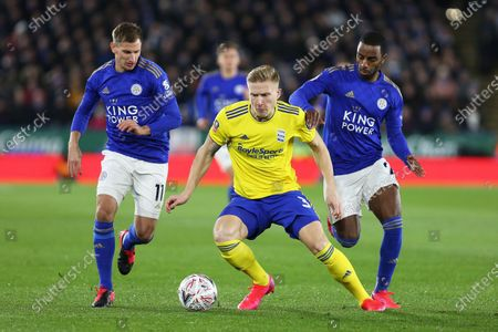Birmingham City defender Kristian Pedersen, Leicester City midfielder Marc Albrighton and Leicester City defender Ricardo Pereira compete for the ball during the The FA Cup match between Leicester City and Birmingham City at the King Power Stadium, Leicester