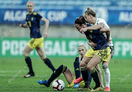Germany's Giulia Gwinn (R) in action against Sweden's Jessica Samuelsson (2-R) during the Algarve Cup soccer match between Germany and Sweden held at Algarve stadium, in Loule, Faro, south of Portugal, 04 March 2020.