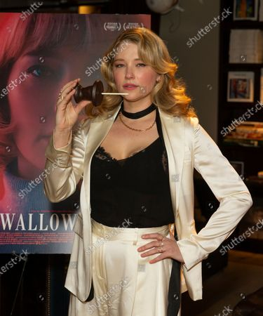 Haley Bennett holds chocolate creation by Savinien Caracostea