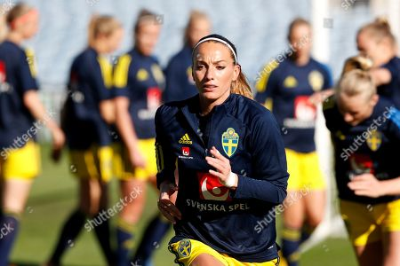 Sweden's Kosovare Asllani runs during warmup before the Algarve Cup women's soccer match between Germany and Sweden at the Algarve stadium, outside Faro, Portugal